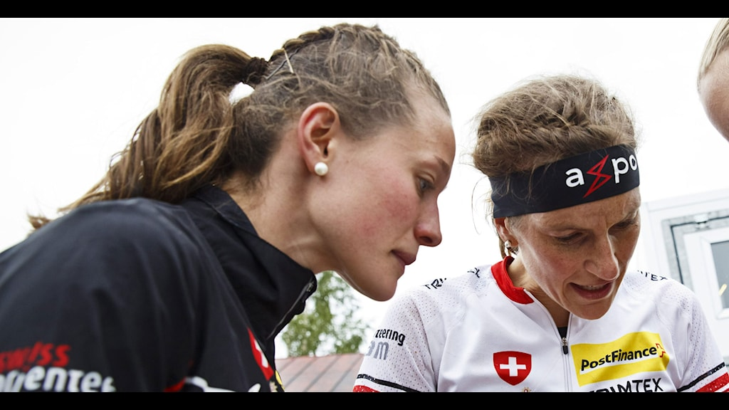 From left, Judith Wyder, Simone Niggli and Sara Luscher of third-placed team Switzerland check the map after the women's relay, in the World Orienteering Championships 2013, in Sotkamo, Finland, Saturday, July 13, 2013. Norway won the event ahead of Finland and Switzerland. AP Photo/Lehtikuva, Roni Rekomaa