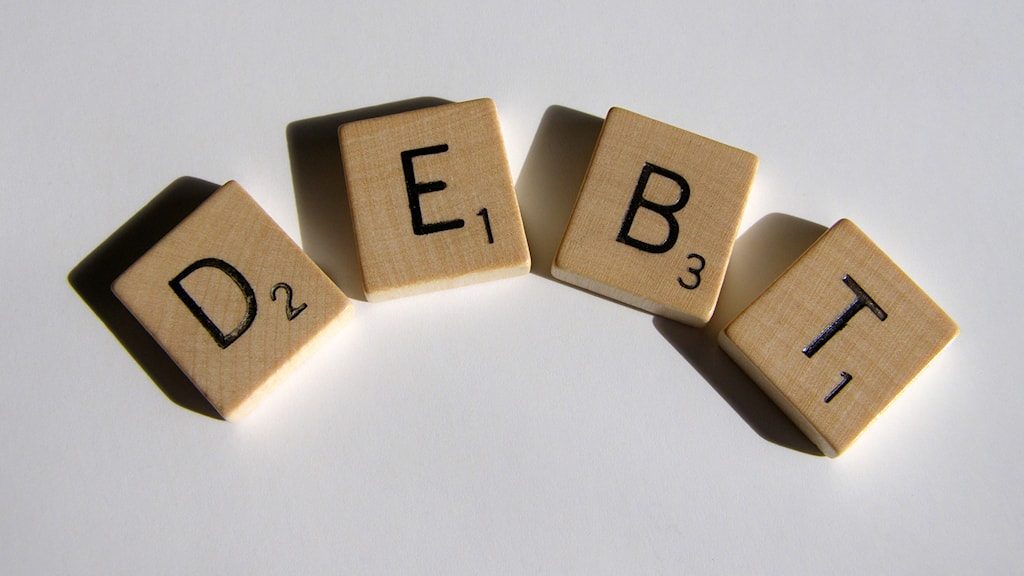 "Photo: ""Scrabble Series Debt"" by Chris Potter / www.StockMonkeys.com. CC by 2.0. https://flic.kr/p/dAn2YT"